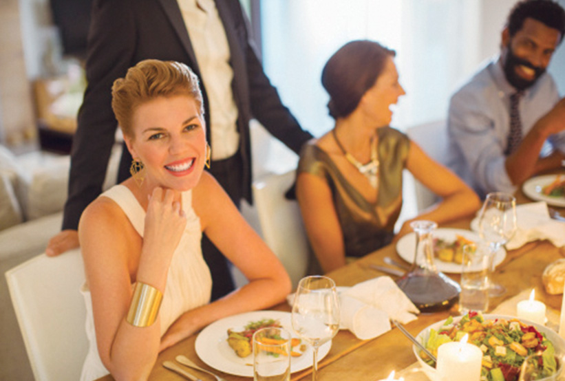 Woman enjoying luxury dining experience