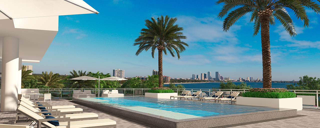 luxurious pool and waterfront condo on sunny day