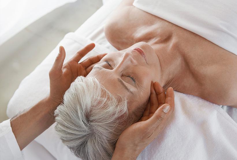 Woman getting a massage at Virage Bayshore