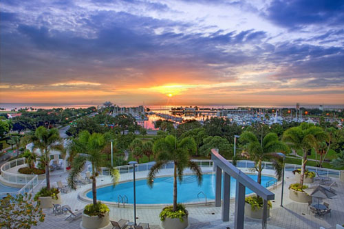 waterfront view of bayshore blvd and pool at sunset