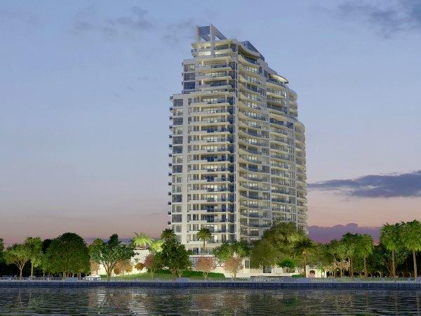 luxury condominium exterior photo at night